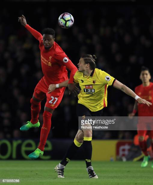 Divock Origi of Liverpool heads the ballunder pressure from Sebastian Prodl of Watford during the Premier League match between Watford and Liverpool...