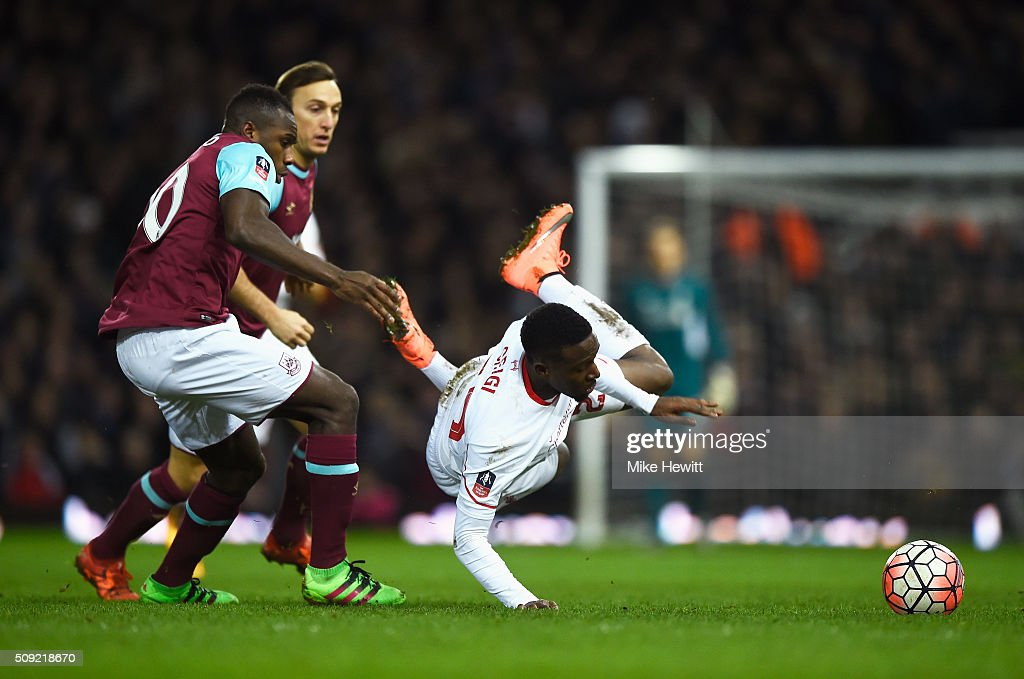 <a gi-track='captionPersonalityLinkClicked' href=/galleries/search?phrase=Divock+Origi&family=editorial&specificpeople=10183754 ng-click='$event.stopPropagation()'>Divock Origi</a> of Liverpool is tripped by <a gi-track='captionPersonalityLinkClicked' href=/galleries/search?phrase=Michail+Antonio&family=editorial&specificpeople=5806303 ng-click='$event.stopPropagation()'>Michail Antonio</a> of West Ham United during the Emirates FA Cup Fourth Round Replay match between West Ham United and Liverpool at Boleyn Ground on February 9, 2016 in London, England.