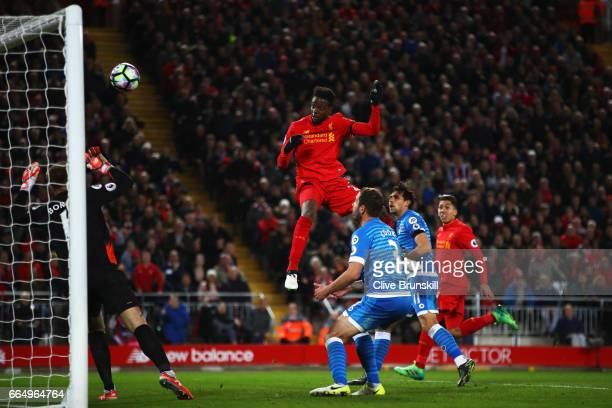 Divock Origi of Liverpool scores his sides second goal during the Premier League match between Liverpool and AFC Bournemouth at Anfield on April 5...