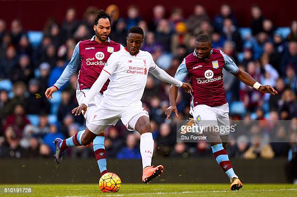 Divock Origi of Liverpool scores his team's fourth goal during the Barclays Premier League match between Aston Villa and Liverpool at Villa Park on...