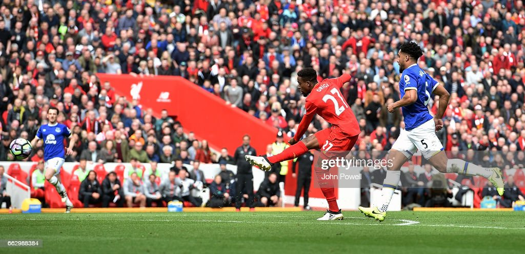 Divock Origi of Liverpool scores the third goal during the Premier League match between Liverpool and Everton at Anfield on April 1, 2017 in Liverpool, England.