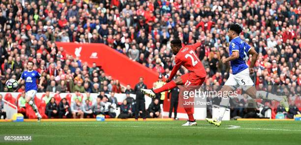 Divock Origi of Liverpool scores the third goal during the Premier League match between Liverpool and Everton at Anfield on April 1 2017 in Liverpool...