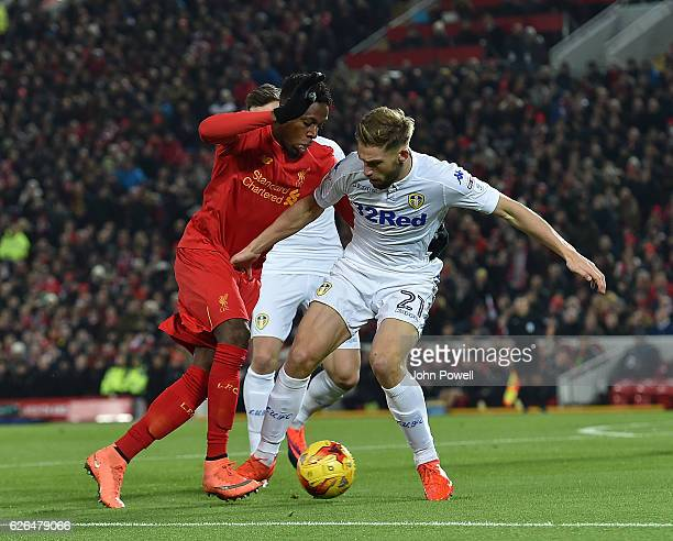Divock Origi of Liverpool with Charlie Taylor of Leeds during the EFL Cup QuarterFinal match between Liverpool and Leeds United at Anfield on...