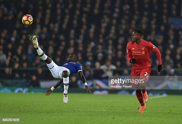 Divock Origi of Liverpool With Idrissa Gana Gueye of Everton during the Premier League match between Everton and Liverpool at Goodison Park on...