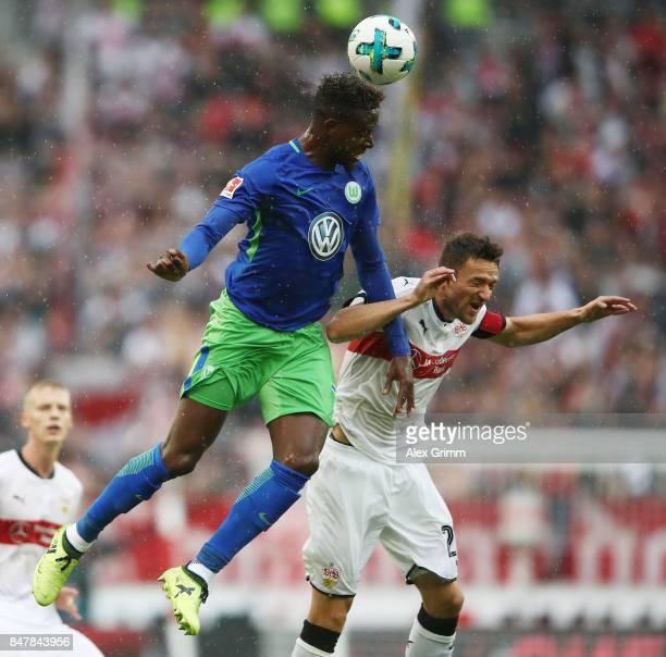 Divock Origi of Stuttgart fights for the ball with Christian Gentnerof Stuttgart during the Bundesliga match between VfB Stuttgart and VfL Wolfsburg...