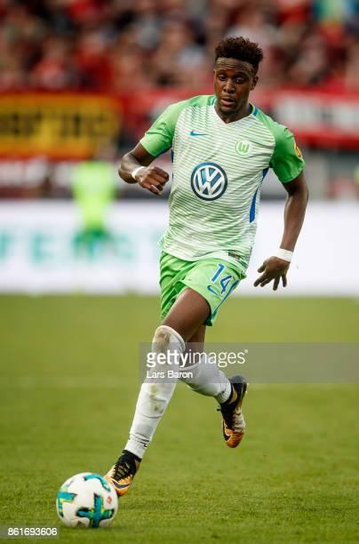 Divock Origi of Wolfsburg runs with the ball during the Bundesliga match between Bayer 04 Leverkusen and VfL Wolfsburg at BayArena on October 15 2017...