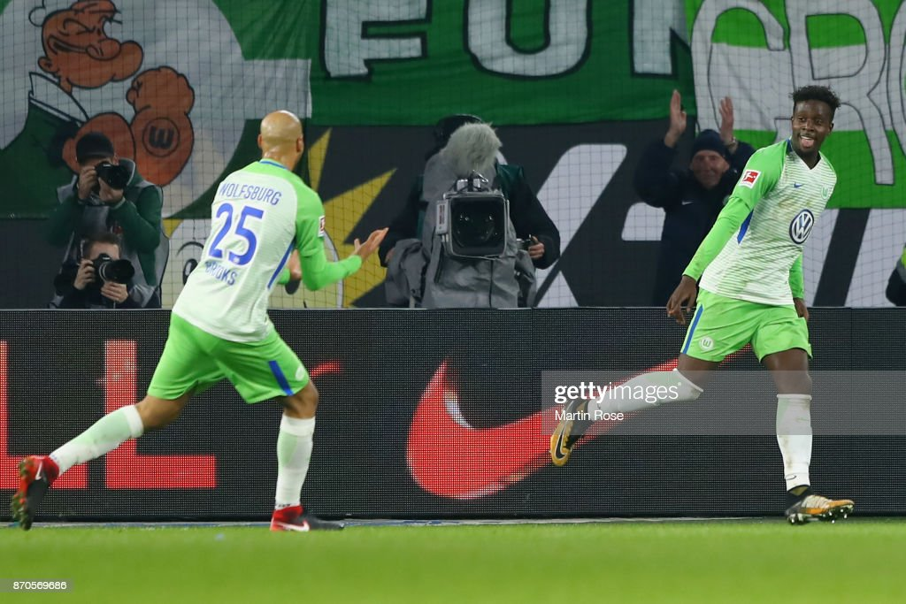 Divock Origi R) of Wolfsburg celebrates his team's third goal with team mate John Anthony Brooks during the Bundesliga match between VfL Wolfsburg and Hertha BSC at Volkswagen Arena on November 5, 2017 in Wolfsburg, Germany.