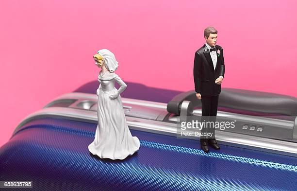 Divorce honeymoon couple on suitcase