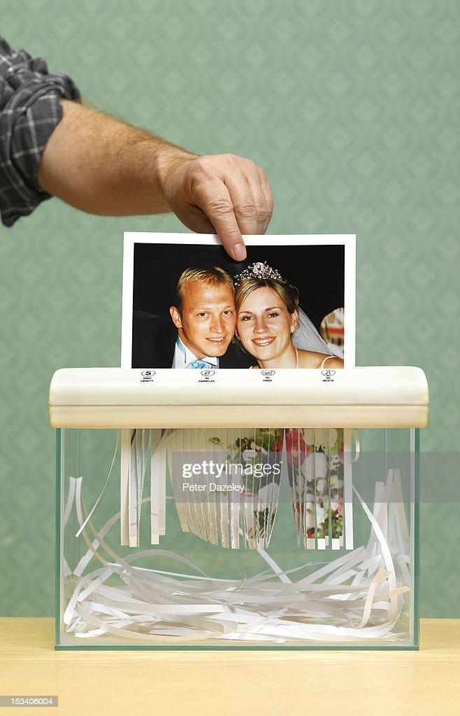 Divorced husband shredding wedding photo : Stock Photo