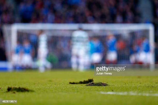 Divots are seen on the pitch during the Scottish League Cup SemiFinal between Celtic and Rangers at Hampden Park on February 1 2015 in Glasgow...