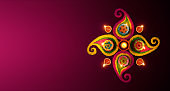 Diwali celebration - Diya oil lamps lit on colorful rangoli