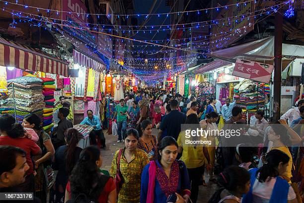 Diwali lights illuminate shoppers in a crowded shopping street in the suburb of Lajpat Nagar in New Delhi India on Thursday Oct 31 2013 The Hindu...