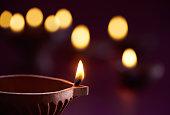 Traditional clay diya lamps lit during diwali celebration