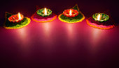 Diwali oil lamp - Colorful clay diya lamps lit during diwali celebration
