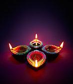 Colorful clay diya lamps lit during diwali celebration