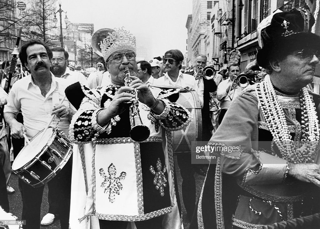 Dixieland clarinetist Pete Fountain (1930- ) leads the 'Half-Fast' marching band down Canal Street in New Orleans, to begin the annual Mardi Gras celebration.