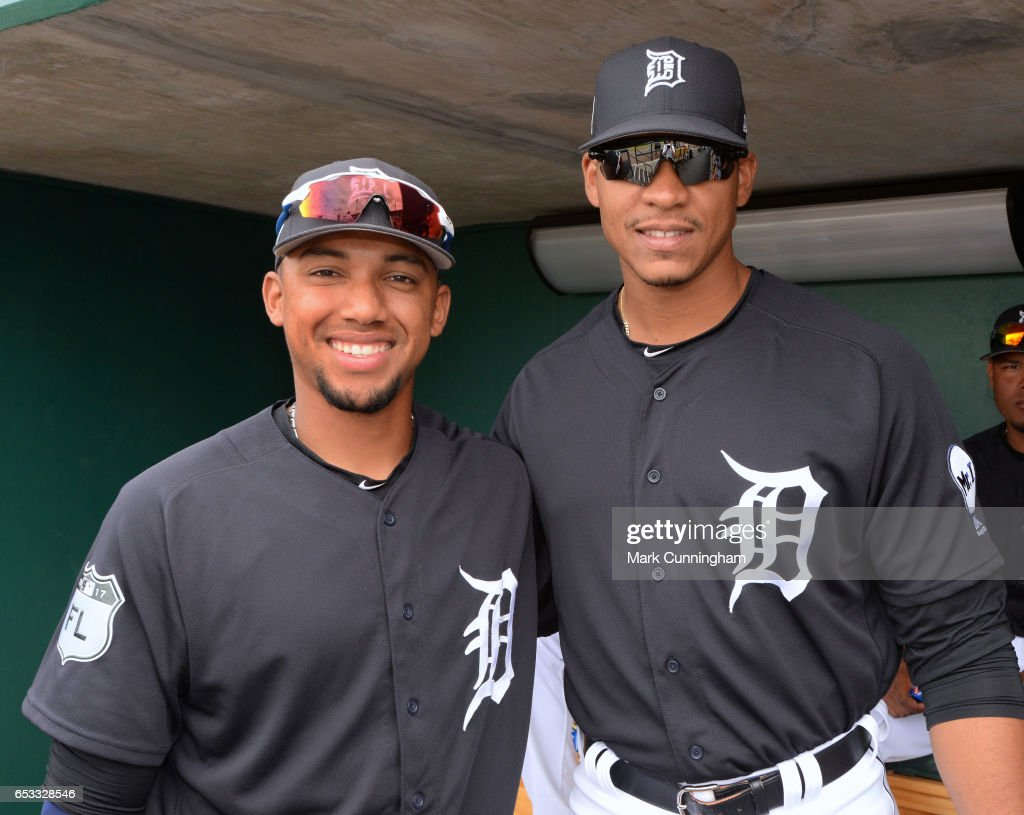 Dixon Machado #49 (L) and Steven Moya #33 of the Detroit Tigers pose for a photo prior to the Spring Training game against the New York Mets at Publix Field at Joker Marchant Stadium on March 12, 2017 in Lakeland, Florida. The Tigers defeated the Mets 4-3.