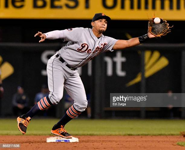 Dixon Machado of the Detroit Tigers catches a ball thrown by Andrew Romine prior to getting the force out on Lorenzo Cain of the Kansas City Royals...