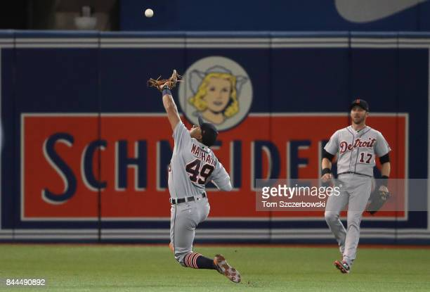Dixon Machado of the Detroit Tigers catches a pop up in the fourth inning during MLB game action against the Toronto Blue Jays at Rogers Centre on...