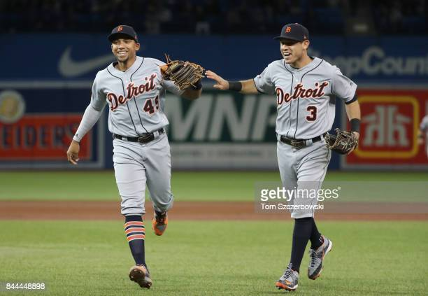 Dixon Machado of the Detroit Tigers celebrates with Ian Kinsler after turning a triple play in the sixth inning during MLB game action against the...
