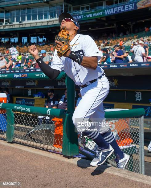 Dixon Machado of the Detroit Tigers looks up to the sky as he heads out to the field to start the game during a MLB game against the Minnesota Twins...