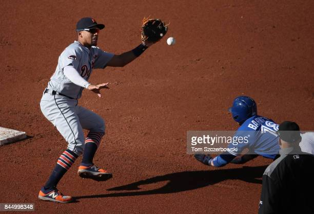 Dixon Machado of the Detroit Tigers prepares to tag out Darwin Barney of the Toronto Blue Jays as he is caught stealing second base in the second...