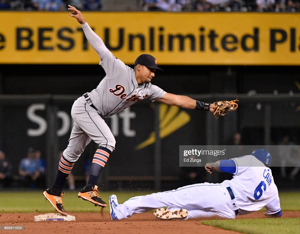 Dixon Machado #49 of the Detroit Tigers steps on second as he gets the force out on Lorenzo Cain #6 of the Kansas City Royals in the fourth inning at Kauffman Stadium on September 28, 2017 in Kansas City, Missouri.