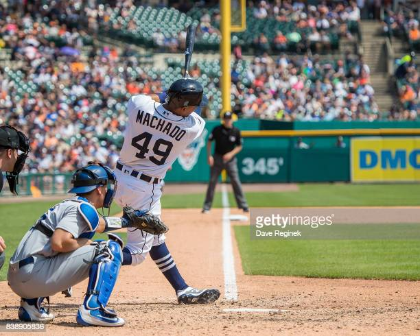 Dixon Machado of the Detroit Tigers swings and makes contact in the sixth inning against the Los Angeles Dodgers during a MLB game at Comerica Park...