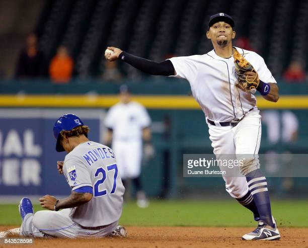 Dixon Machado of the Detroit Tigers turns the ball after getting a force out on Raul Mondesi of the Kansas City Royals during the ninth inning at...