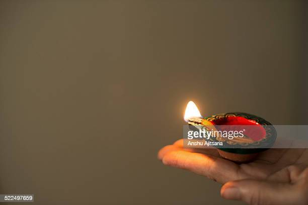 Diya in outstretched hand
