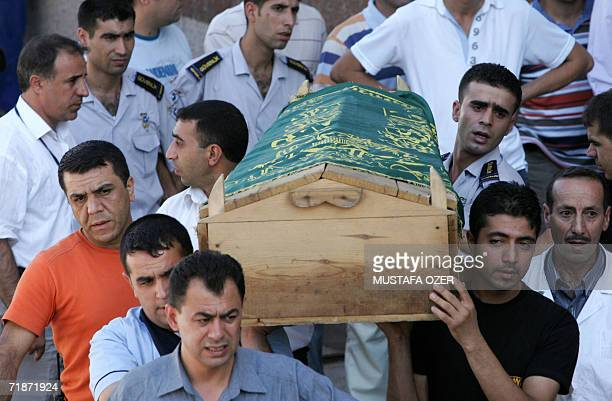Relatives carry the coffin of bomb blast victim at a hospital in DiyarbakirTurkey 13 September 2006Ten people including seven children were killed in...