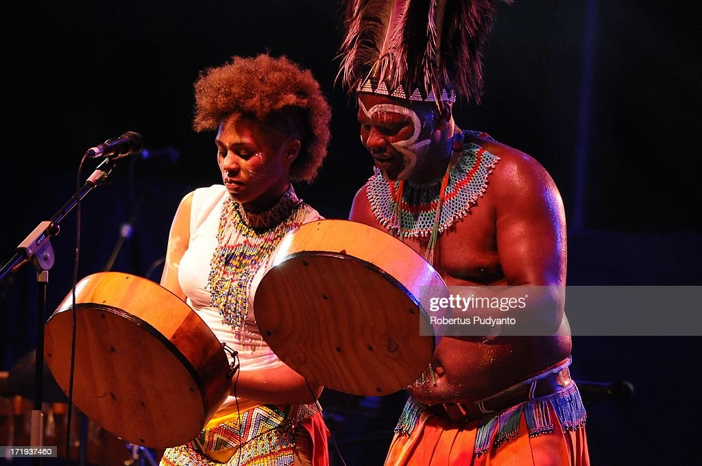 Dizu Plaatjies and The Ibuyambo Ensemble of South Africa featuring sub-Saharan African music with painted warriors, female dancers, traditional music played on hand made instruments, exulted voices, wonderful instrumental textures, and thrilling percussion in Rainforest World Music Festival at Sarawak Cultural Village on June 29, 2013 in Kuching, Sarawak, Malaysia.