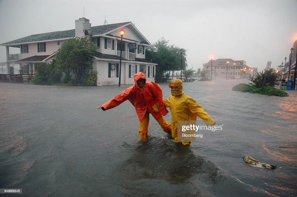 Dizy Brown and her son Christopher ply the knee deep waters of Front Street in Beaufort North Carolina at the peak of Hurricane Opheiila on Wednesday...
