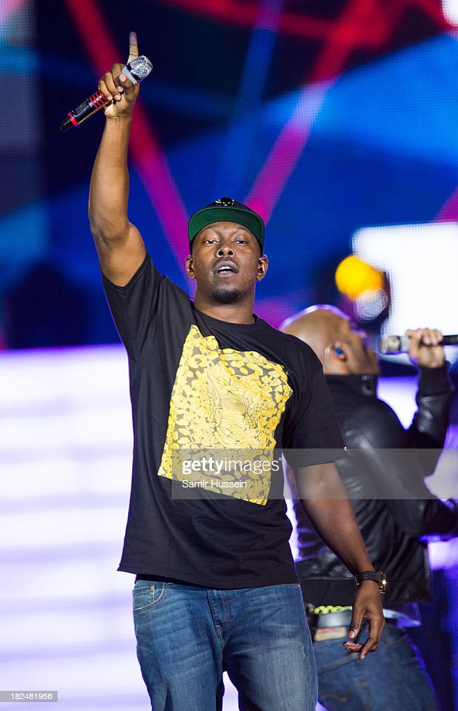 Dizzee Rascal appears live on stage at the Unity concert in memory of Stephen Lawrence at O2 Arena on September 29, 2013 in London, England.