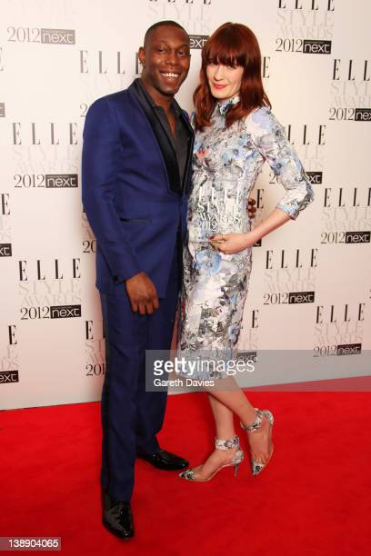 Dizzee Rascal poses with Florence Welch after presenting her with the Best Music Act Award in the press room at The ELLE Style Awards 2012 at The...