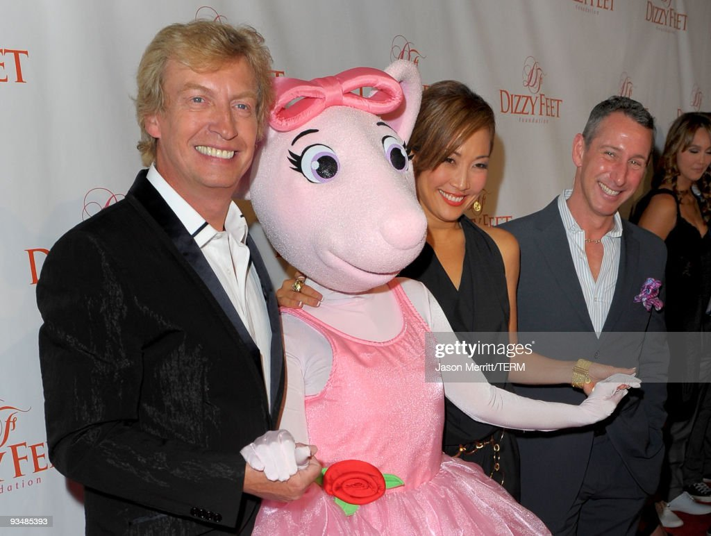 Dizzy Feet Foundation founding members <a gi-track='captionPersonalityLinkClicked' href=/galleries/search?phrase=Nigel+Lythgoe&family=editorial&specificpeople=736462 ng-click='$event.stopPropagation()'>Nigel Lythgoe</a>, Angelina Ballerina, <a gi-track='captionPersonalityLinkClicked' href=/galleries/search?phrase=Carrie+Ann+Inaba&family=editorial&specificpeople=637379 ng-click='$event.stopPropagation()'>Carrie Ann Inaba</a> and <a gi-track='captionPersonalityLinkClicked' href=/galleries/search?phrase=Adam+Shankman&family=editorial&specificpeople=1295239 ng-click='$event.stopPropagation()'>Adam Shankman</a> arrive at the Dizzy Feet Foundation's Inaugural Celebration of Dance at The Kodak Theater on November 29, 2009 in Hollywood, California.