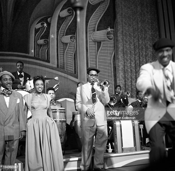 Dizzy Gillespie conducts his BeBop Orchestra including Teddy Stewart on drums and Maxine Sullivan at the Strand Theater on Broadway on December 10...