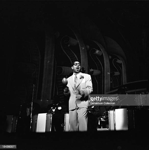 Dizzy Gillespie conducts his his BeBop Orchestra including Teddy Stewart on drums at the Strand Theater on Broadway on December 10 1948 in New York...
