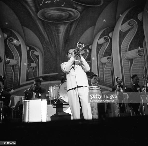 Dizzy Gillespie plays trumpet and conducts his BeBop Orchestra at the Strand Theater on Broadway on December 10 1948 in New York New York