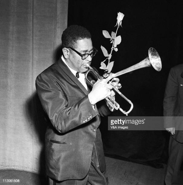 Dizzy Gillespie posed with rose and trumpet 1959