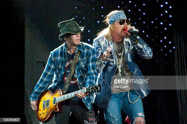 Dj Ashba and Axl Rose of Guns N' Roses perform on stage during the opening night of the Chinese Democracy UK tour at O2 Arena on October 13 2010 in...