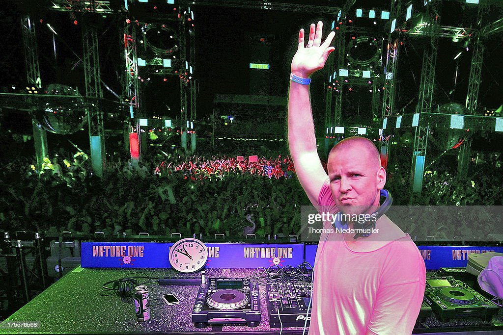 Dj Moguai performs at the 'Nature One' massive rave, held at the former US rocket base Pydna on August 3, 2013 in Kastellaun, Germany.