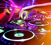 Dj playing the track in nightclub at party