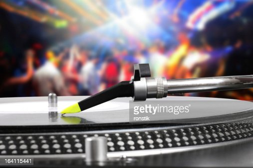 dj turntable with vinyl record in the dance club : Stock Photo