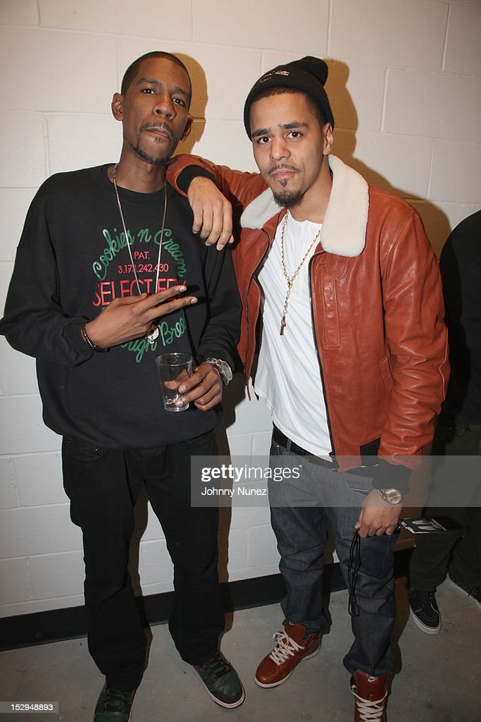 Dj Young Guru and <a gi-track='captionPersonalityLinkClicked' href=/galleries/search?phrase=J.+Cole&family=editorial&specificpeople=5958978 ng-click='$event.stopPropagation()'>J. Cole</a> backstage at the exclusive D'USSE VIP Lounge at Barclays Center on September 28, 2012 in New York City.