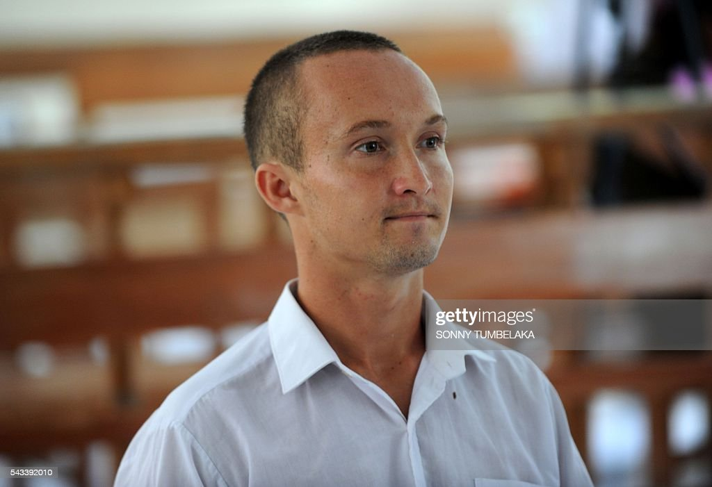 Djai Heijn of the Netherlands listens to the Indonesia judges during his drugs trial at a court in Denpasar, on Indonesia's resort island of Bali on June 28, 2016. The Indonesian prosecutor has recommended a 10-month prison sentence for Heijn, who was arrested by customs and police officers on January 11 for allegedly taking receipt of a package sent from Spain which contained 224 grams of marijuana. / AFP / SONNY