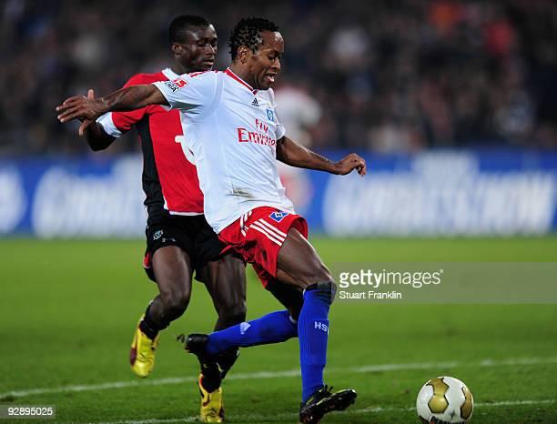 Djakpa Constant of Hannover 96 challenges Ze Roberto of Hamburg during the Bundesliga match between Hannover 96 and Hamburger SV at AWDArena on...