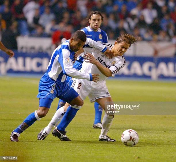 Djalminha of Deportivo and Michel Salgado of Real Madrid fight for the ball during the Spanish Primera Liga match between Deportivo de La Coruna and...