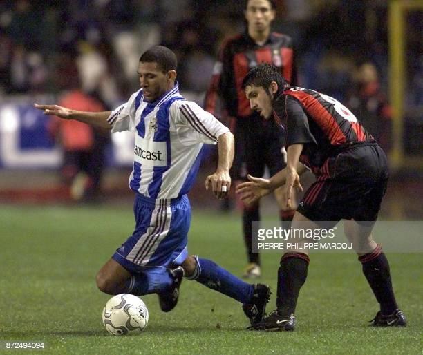 Djalminha of Deportivo la Coruna falls in front of Gennaro Gattuso of Milan AC 06 December 2000 during their Champions league match in La Coruna /...
