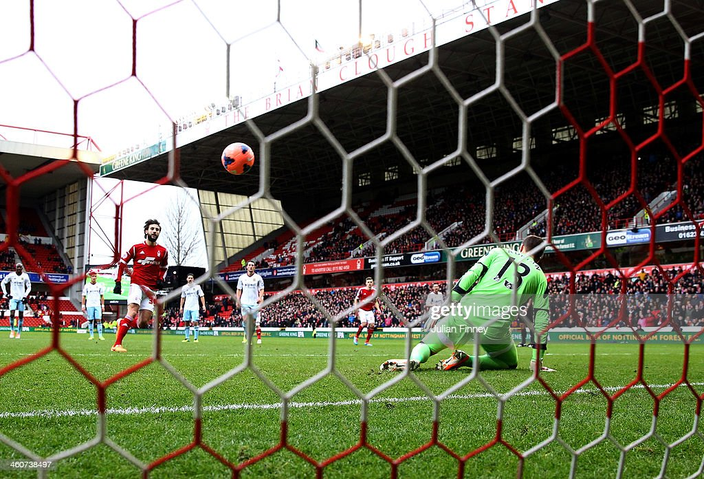 Djamel Abdoun of Nottingham Forest chips a penalty kick past goalkeeper Adrian of West Ham United to score their first goal during the FA Cup with Budweiser Third round match between Nottingham Forest and West Ham United at City Ground on January 5, 2014 in Nottingham, England.